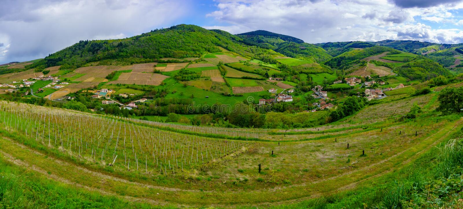 Panoramic landscape of vineyards and countryside in Beaujolais. Rhone department, France royalty free stock photos