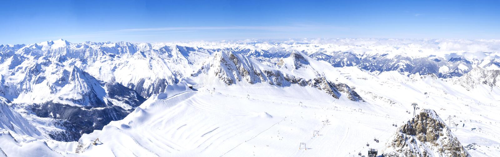 Panoramic landscape Winter view from the top of Kitzsteinhorn mountain on snow covered slopes, blue sky. Kaprun ski. Resort, National Park Hohe Tauern, Austrian stock images