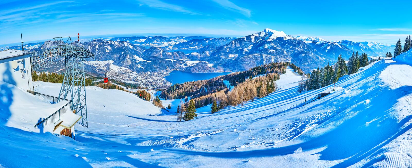 Panoramic landscape from winter Zwolferhorn, St Gilden, Salzkammergut, Austria. The stunning scenery of Eastern Alps of Salzkammergut with a view on Wolfgangsee royalty free stock photo