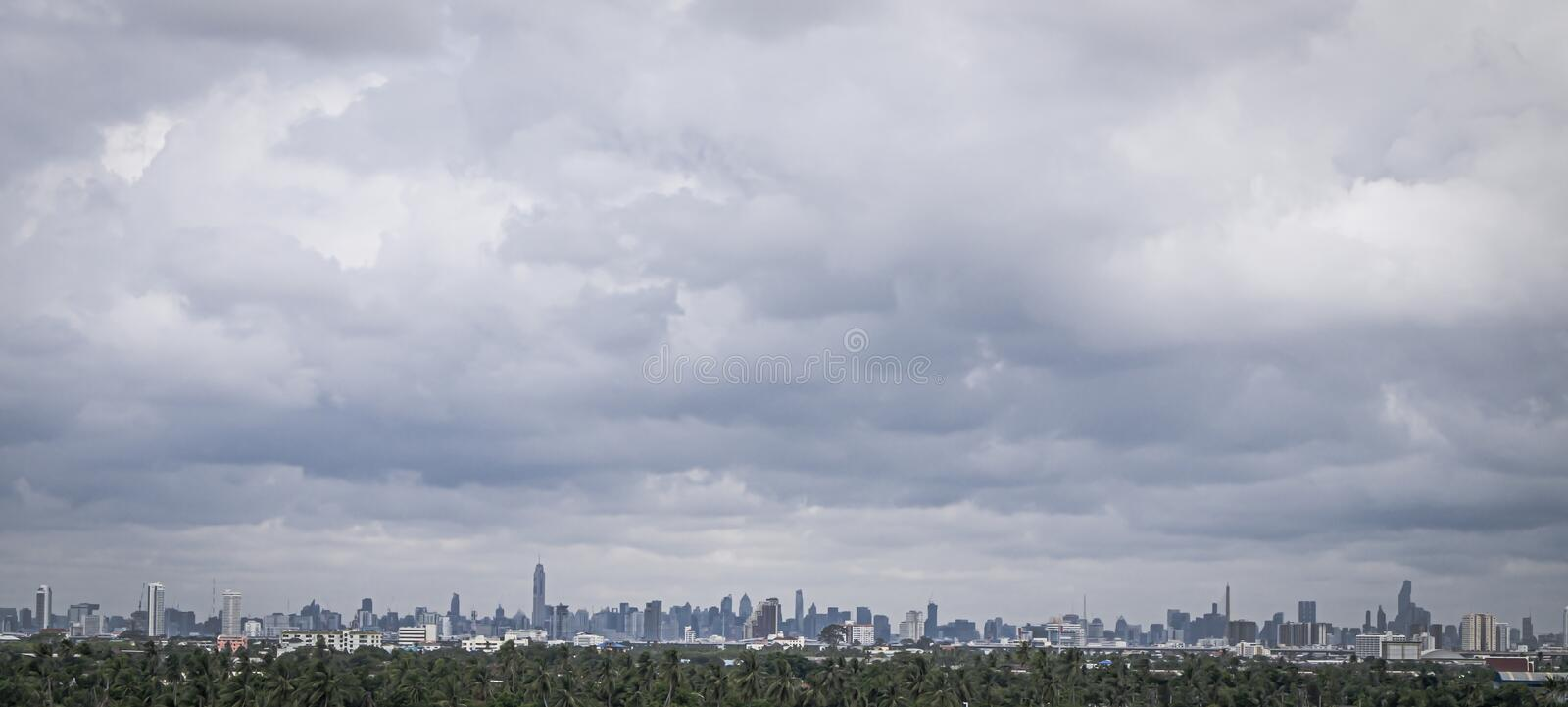 Panoramic landscapes with green forest area or bufffer zone and Modern City Skyline.  stock images