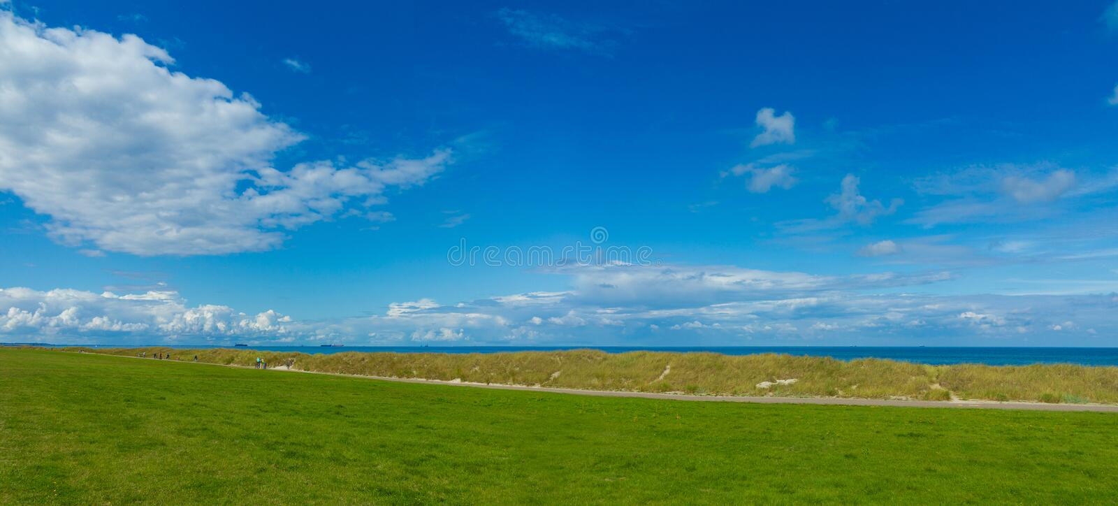 Panoramic landscpae with dunes, dyke and the baltic sea royalty free stock photography