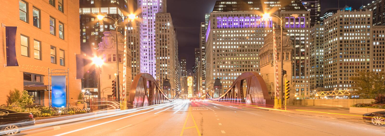 Panoramic light trails and office buildings at North LaSalle Street bridge in downtown Chicago at night stock image