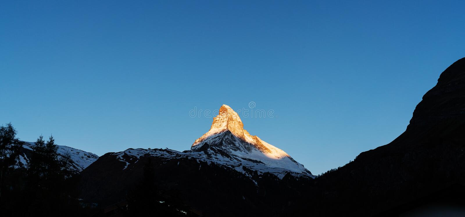 Panoramic, Matterhorn mountain with sunlight on peak in the morning, view at Zermatt Switzerland stock images
