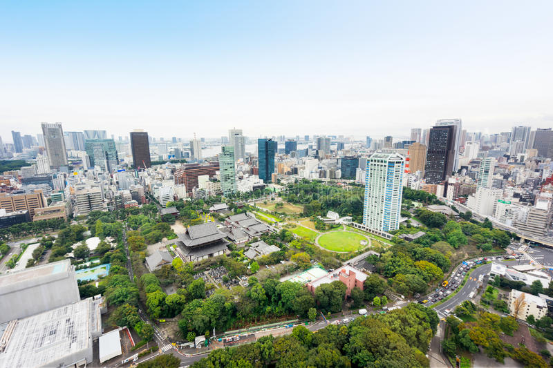 Panoramic modern city skyline bird eye aerial view with zojo-ji temple shrine from tokyo tower under dramatic sunrise and morning. Business and culture concept royalty free stock photos