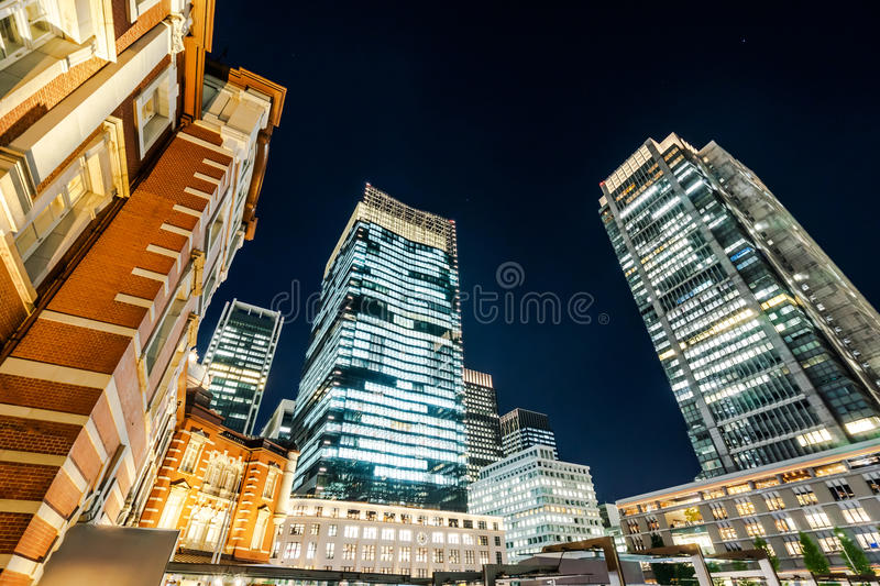 Panoramic modern cityscape building bird eye aerial night view of Tokyo Station under neon light and dark blue sky in Tokyo, Japan. Asia Business concept for stock photo