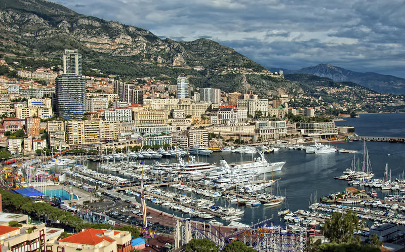 Panoramic of Monte Carlo, Monaco. A panoramic view of the harbor with sailboats and yachts and the high rise buildings of Monte Carlo, Monaco, a district known royalty free stock photography