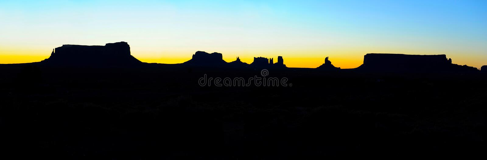 Panoramic Monument Valley sunrise silhouette, Navajo Nation Park stock photography