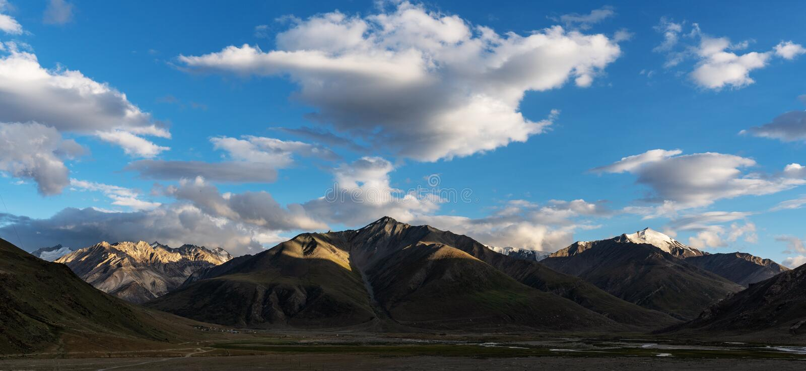 Panoramic mountain landscapes with blue sky and white clouds at Zanskar valley in northern India royalty free stock photo
