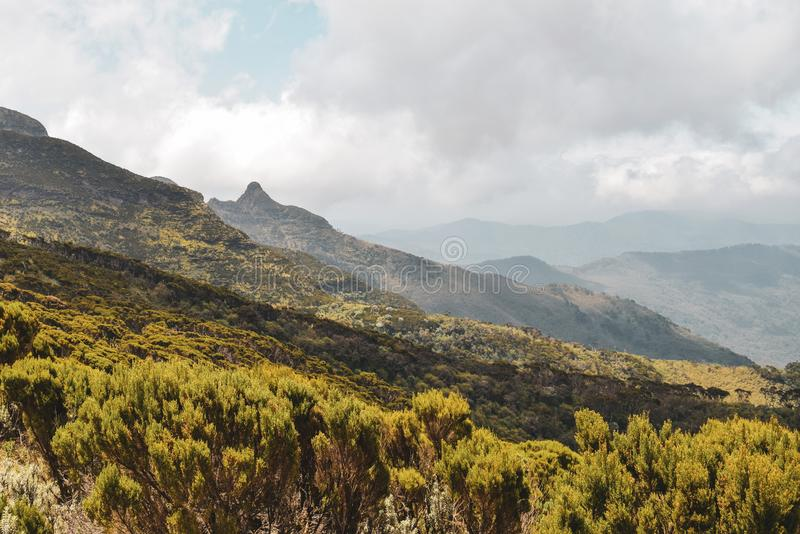 Panoramic mountain landscapes of Mount Kenya. The Volcanic rock formations in the panoramic mountain ranges in rural Kenya, hike, nature, outdoors, africa, fog stock photography