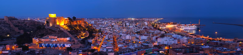 Panoramic night Citadel of Almeria stock photography