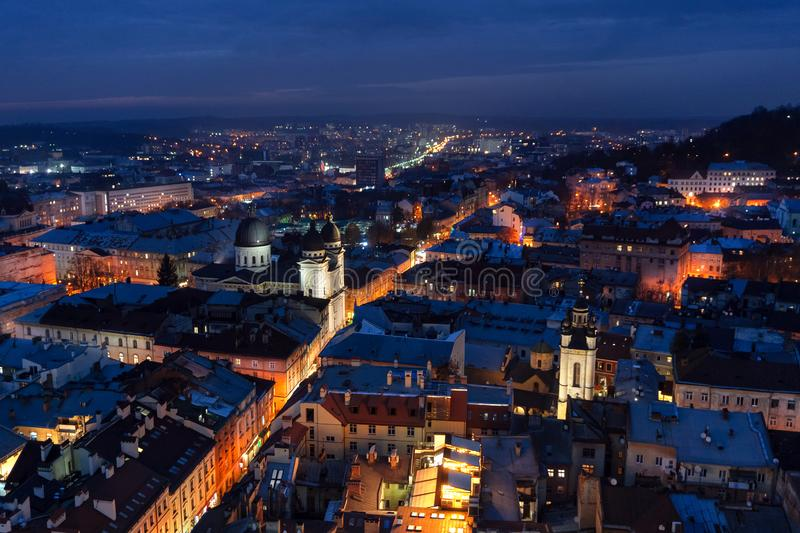 Panoramic night cityscape view on roofs,traffic and domes of Lviv city, Ukraine royalty free stock images