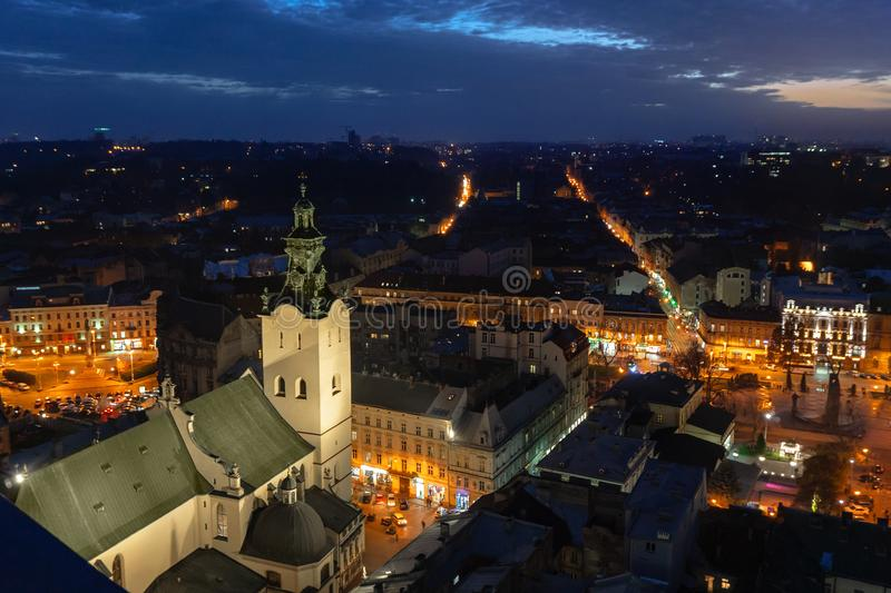 Panoramic night sunset cityscape view on roofs and domes of Lviv, Ukraine stock photography