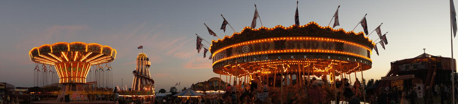 Panoramic night time view of a traditional funfair stock image