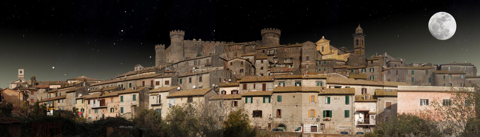 Panoramic night view of Bracciano in the moonlight royalty free stock image