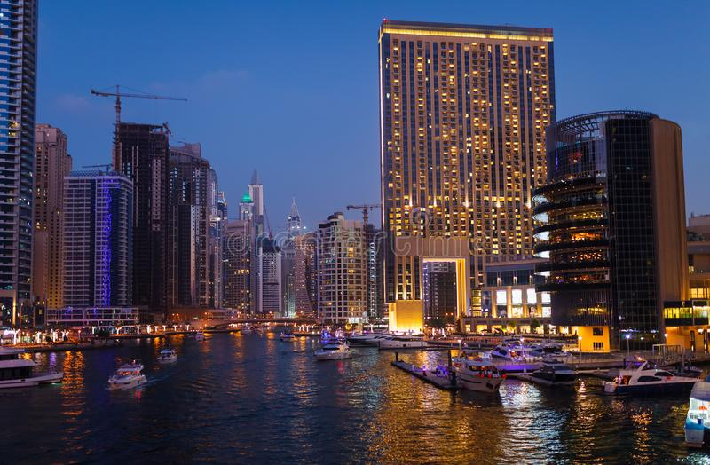 Panoramic night view on downtown of Dubai Marina with modern high skyscrapers. Architecture of future with bright lights and roads stock photography