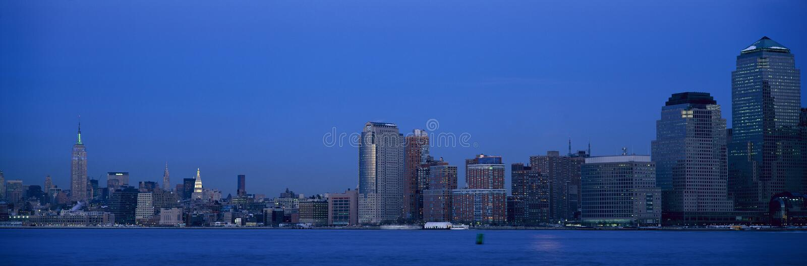 Panoramic night view of Empire State Building and Lower Manhattan skyline, NY where World Trade Towers were located royalty free stock image