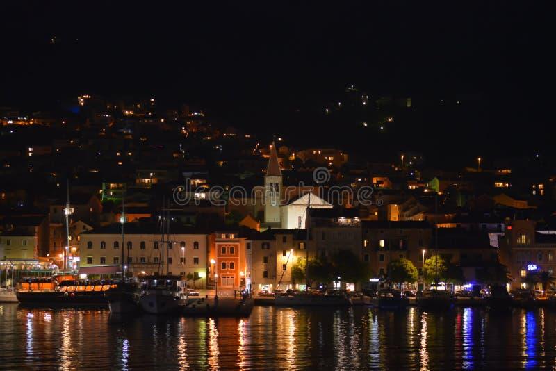 Panoramic night view of Makarska city center from the sea in Makarska, Croatia on June 16, 2019. royalty free stock photography