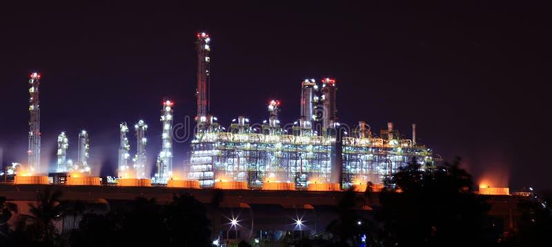 Panoramic oil refinery factory. Panoramic view of oil refinery factory at night royalty free stock photos