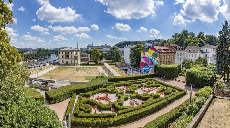 Panoramic outside view from castle in Saarbruecken to castle garden, river Saar and historic houses. SAARBRUECKEN, GERMANY - AUG 5, 2018: panoramic outside view royalty free stock image