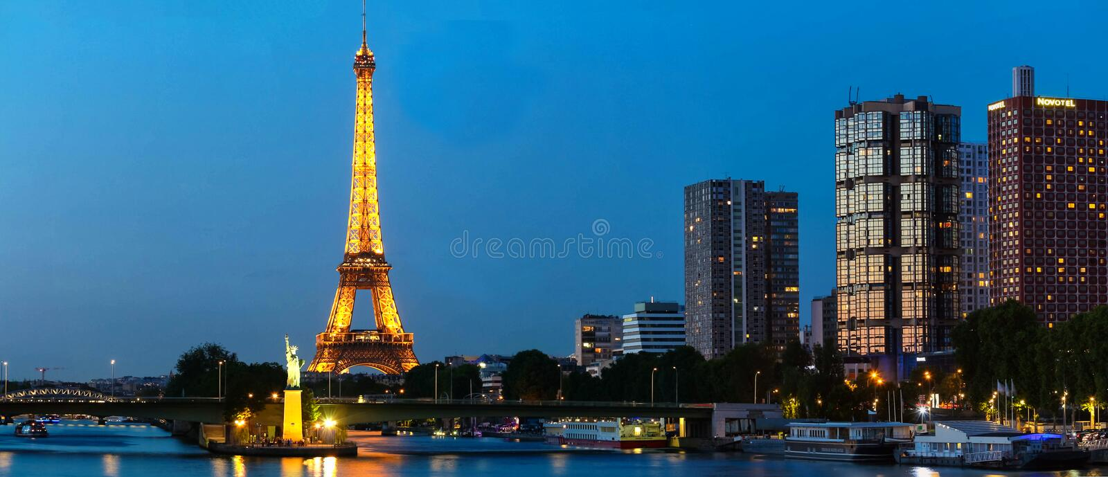 Panoramic Paris cityscape with Eiffel tower, quay de Grenelle at night, Paris, France. royalty free stock images