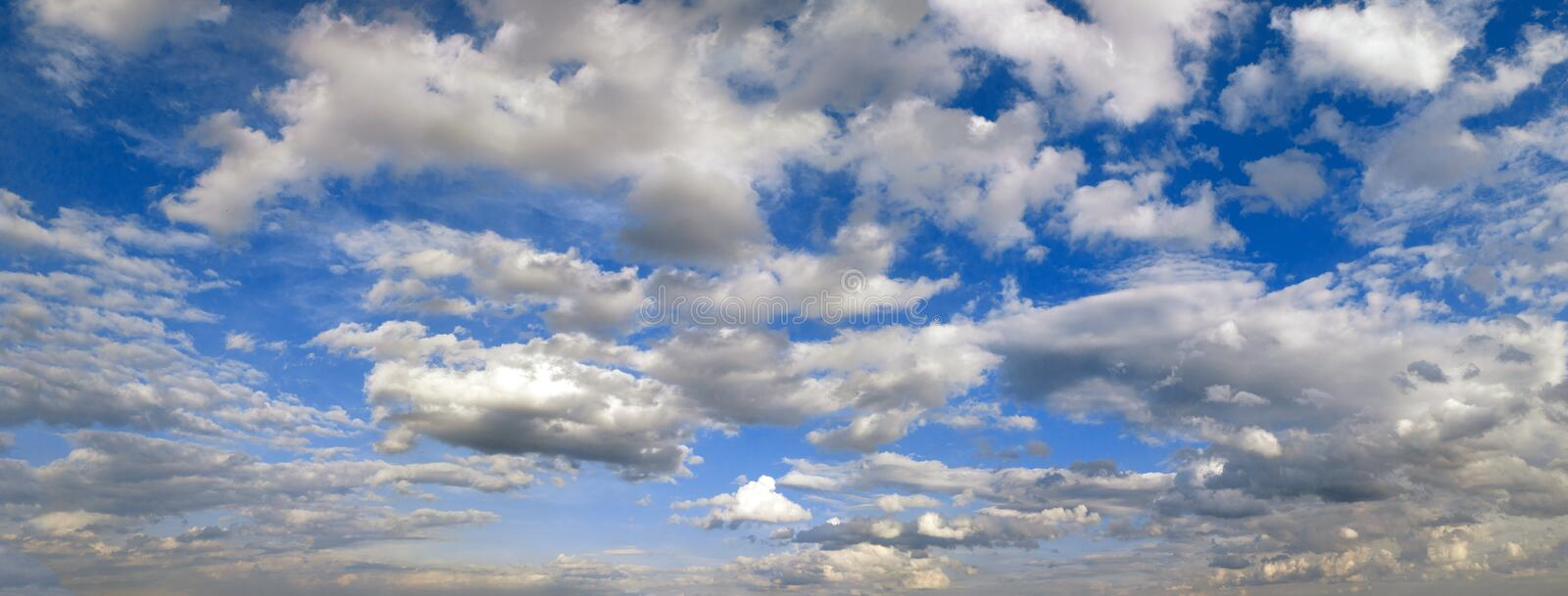 Panoramic photo of the blue sky with clouds in high resolution stock image