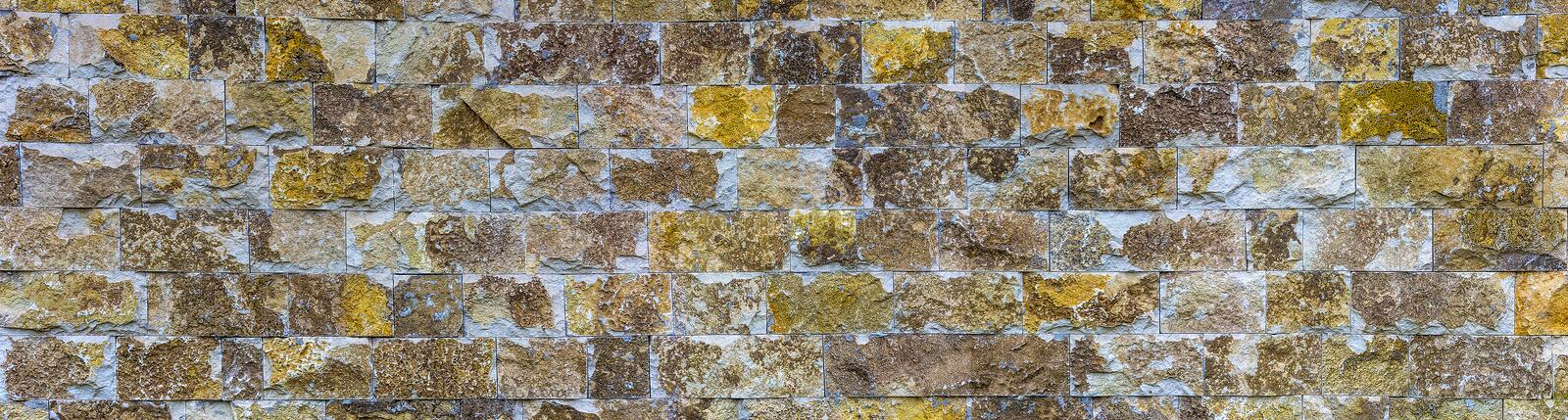 Panoramic photo of a brick wall. Texture for design. it is horizontal modern stone wall for pattern and background. royalty free stock photo