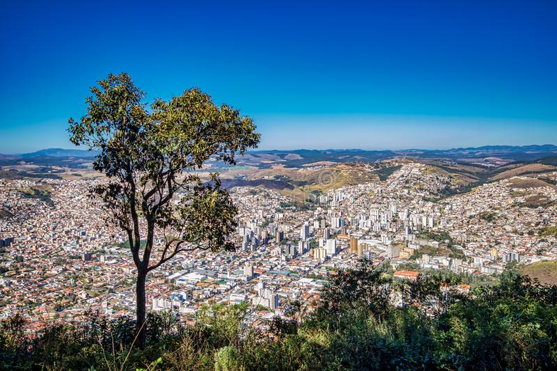 Photo of the city Pocos de Caldas, Minas Gerais - Brazil, from the top of the mountain with blue sky on sunny day. Panoramic photo of the city Pocos de Caldas stock photos