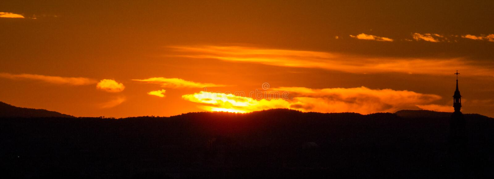Panoramic Photo: Distant Burning sunset royalty free stock images