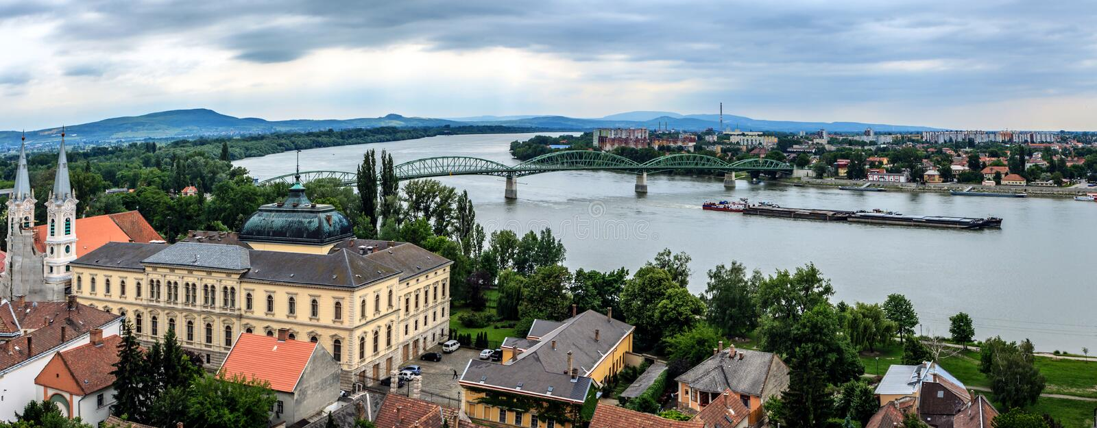 Panoramic photo of Esztergom, Hungary. Panoramic photo of Esztergom with the bridge over the Danube and across the Slovakia. Picture made from the Basilica in stock photos