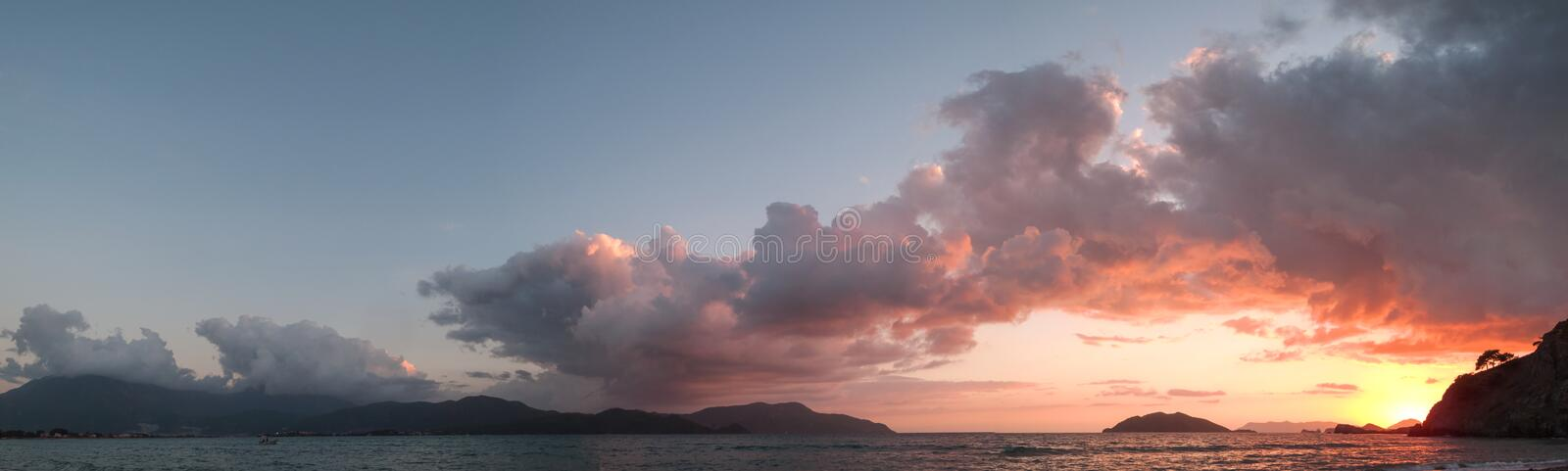 Photo evening sky. Panoramic photo evening sky with cumulus clouds, sunset with sea stock image