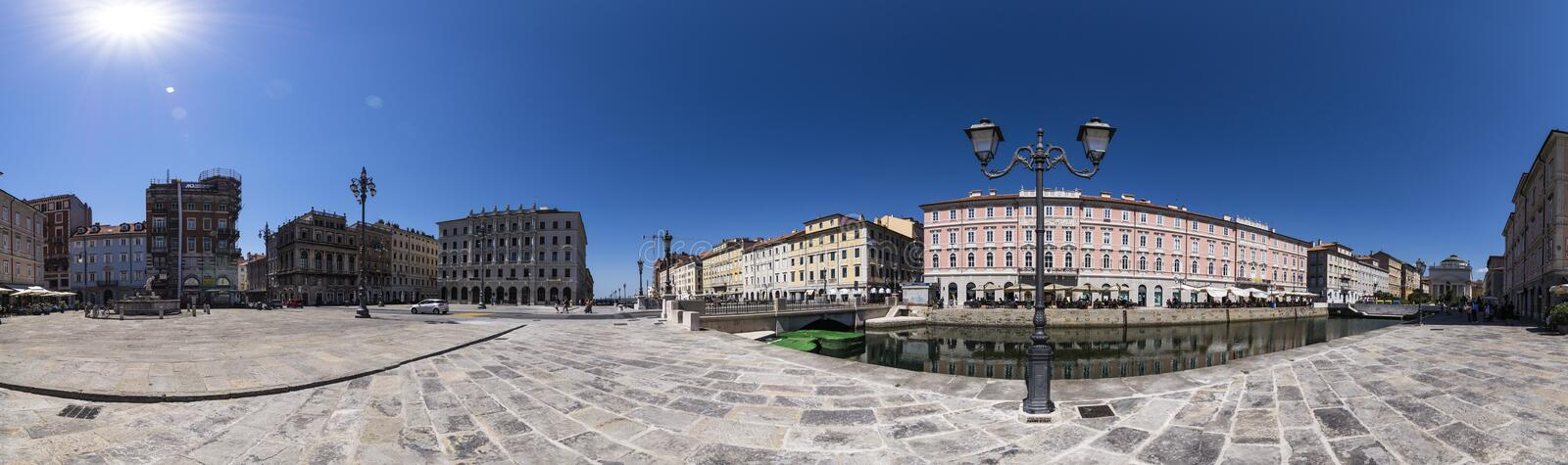 Panoramic photo with the Grand Canal of Trieste and the Piazza del Ponte Rosso, Trieste, Italy. Panoramic photograph of the Grand Canal of Trieste and the Piazza stock photos