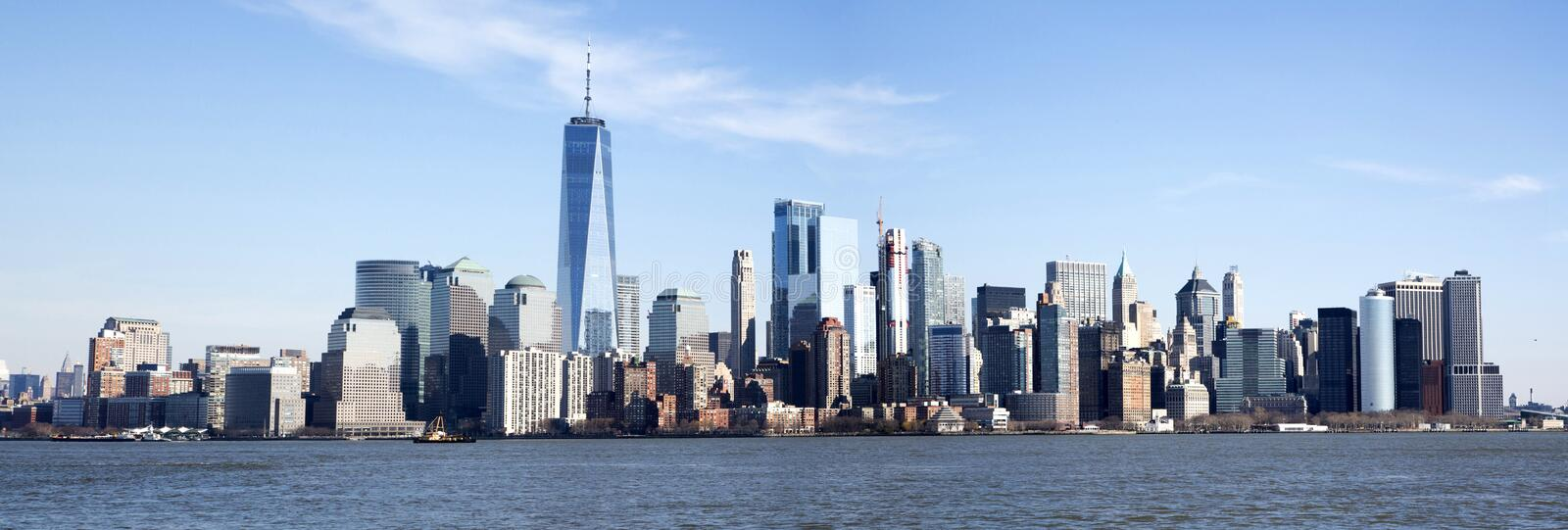 Panoramic photo of the Manhattan skyline. Panorama of the Manhattan skyline seen from Ellis Island across the Hudson River stock images