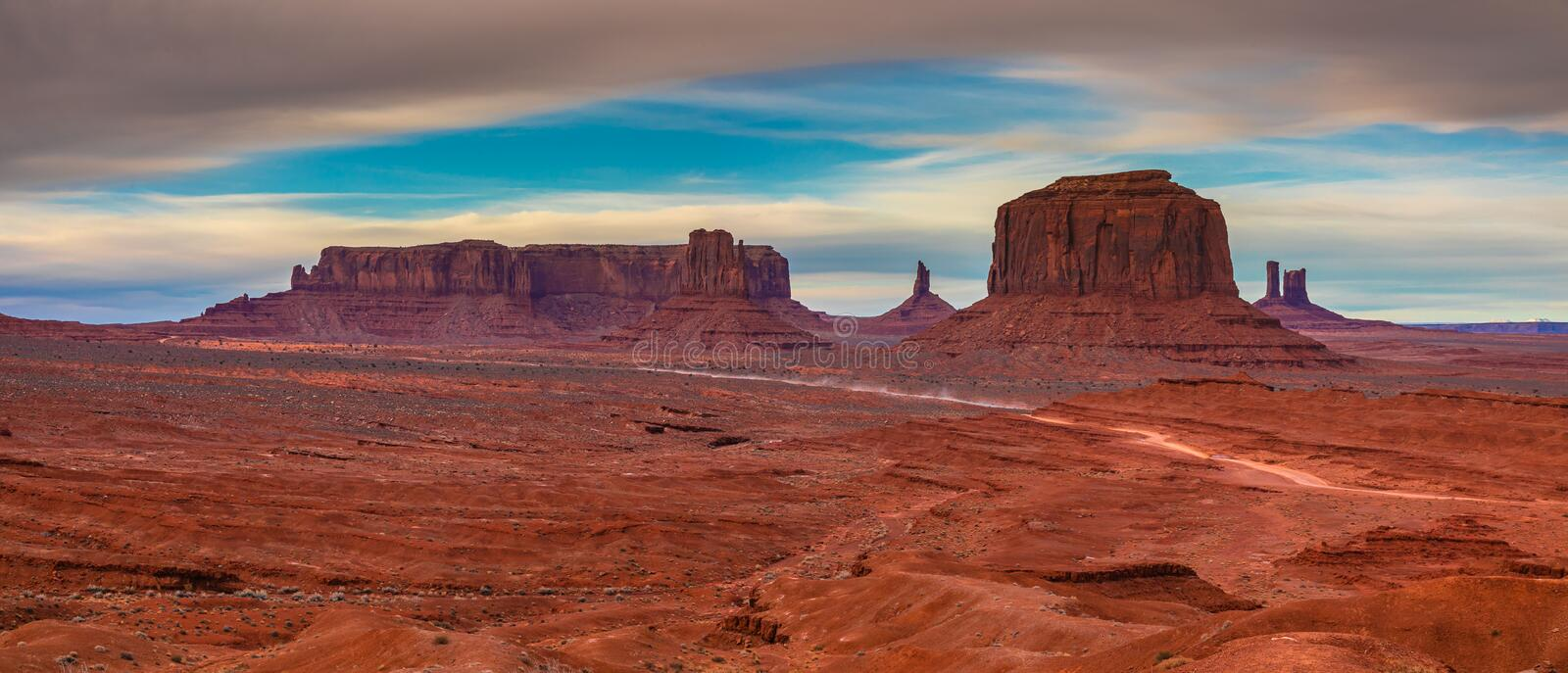 Clouds over Monument Valley, Navajo Land, Utah. A panoramic photo of Monument Valley in a stormy weather. Navajo Land, Utah, USA royalty free stock photos