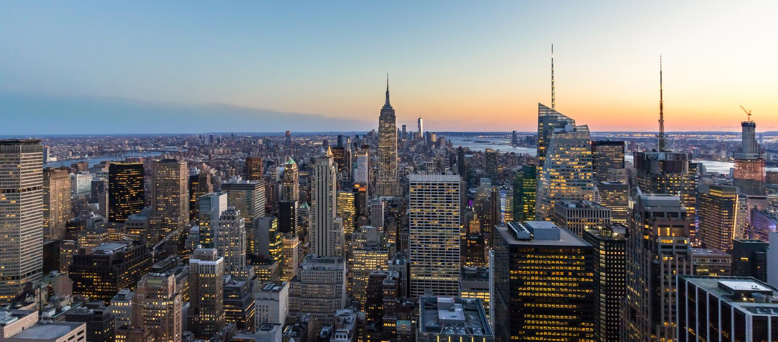 Panoramic photo of New York City Skyline in Manhattan downtown with Empire State Building and skyscrapers at night USA royalty free stock photography