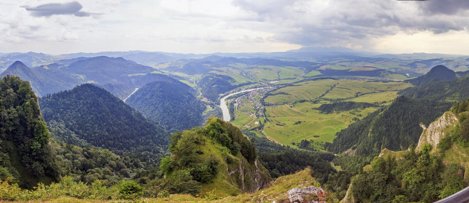 Panoramic photo of Pieniny Mountains, Poland. With large vistas of space down below: peaks, forest, meadows, fields and villages royalty free stock photography