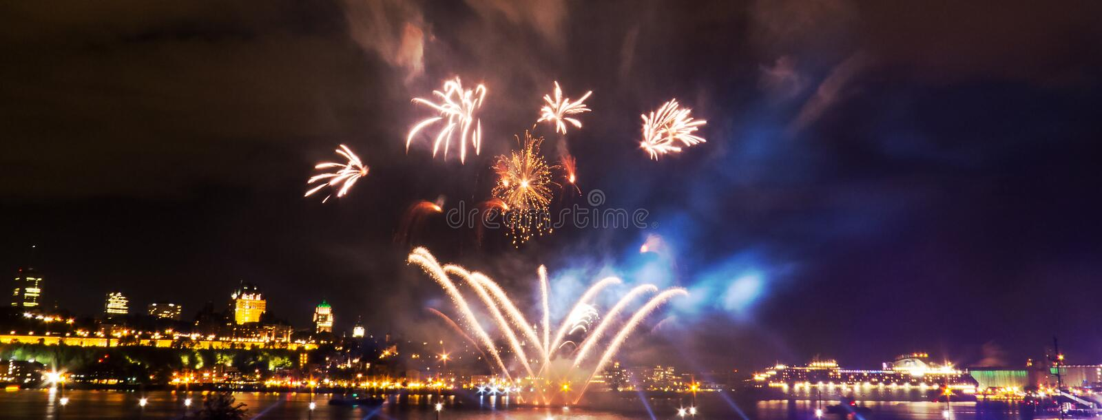 Panoramic photo: Small fireworks over a big river stock photo