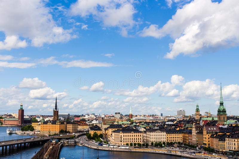 A panoramic photo of Stockholm, sweden. Which features the old town and many connecting bridges, clouds and blue skies royalty free stock images