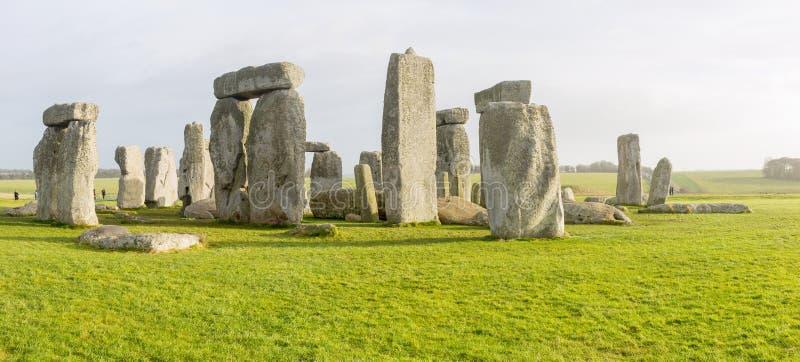 Panoramic Photo of sunny day Stonehenge. Panoramic Photo of Sunny day on Stonehenge, green grass gray sunny sky - UK royalty free stock photography