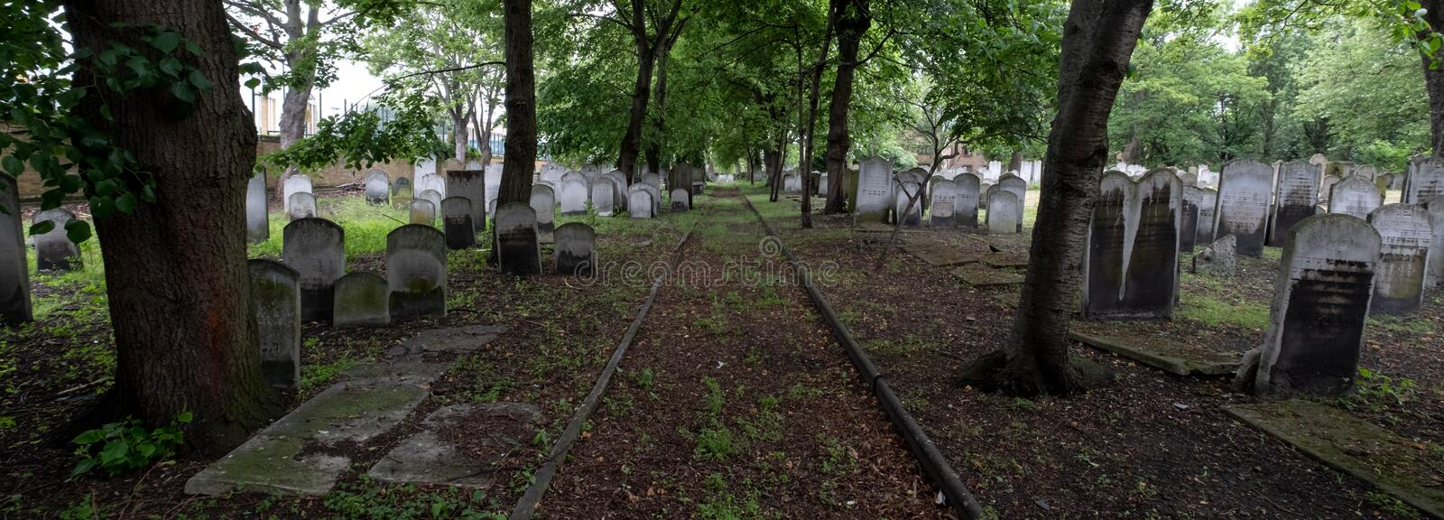 Panoramic photo of tombstones at the historic Jewish cemetery at Brady Street, Whitechapel, East London. London UK. Panoramic photo of tombstones at the royalty free stock images