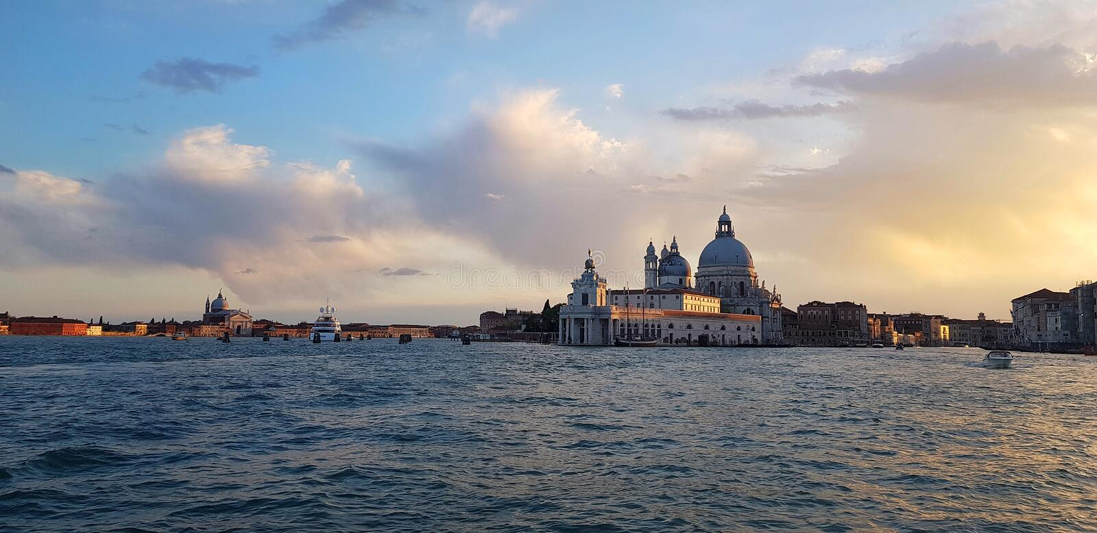 Panoramic photo of the Venetian lagoon in the evening. Traveling in Italy royalty free stock photography