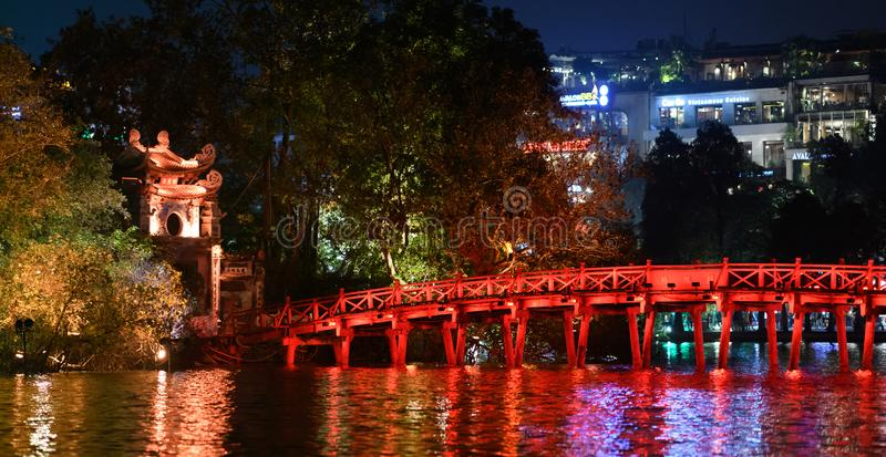 Panorama of the Bridge of the Rising Sun and the entrance to the Ngoc Son temple on Hoan Kiem Lake at night and lit in Vietnam, in. This panoramic photo was stock image