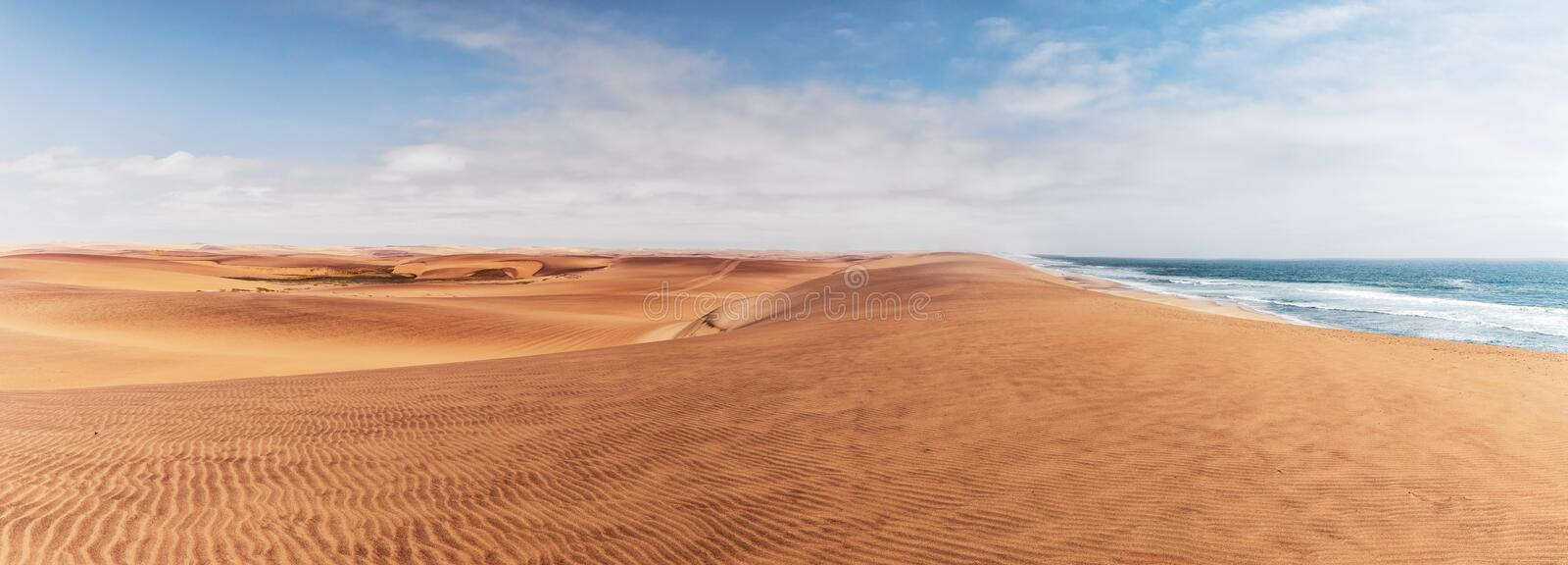 Panoramic Photograph of dunes and ocean on Namibe desert. Africa. Angola. Africa royalty free stock photography