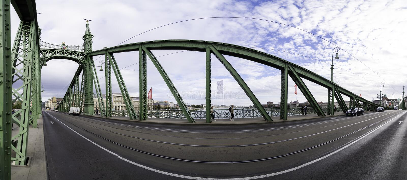 Panoramic photograph of the interior of the Budapest Freedom Bridge, with its cast iron structure and decorated towers. Panoramic photograph of the interior of stock photos