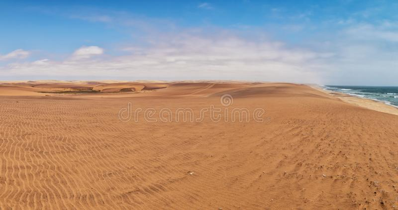 Panoramic Photograph of the Namibe Desert. Coast line with desert dunes. Africa. Angola. Namibe. Africa stock photography