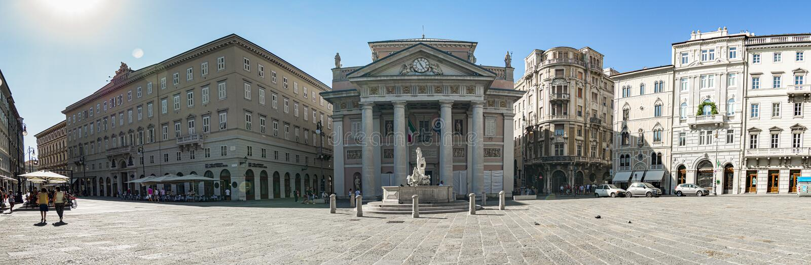 Panoramic photograph of the Piazza della Borsa, Trieste, Italy. Panoramic photograph of the Piazza della Borsa and in the foreground the Chamber of Commerce royalty free stock images