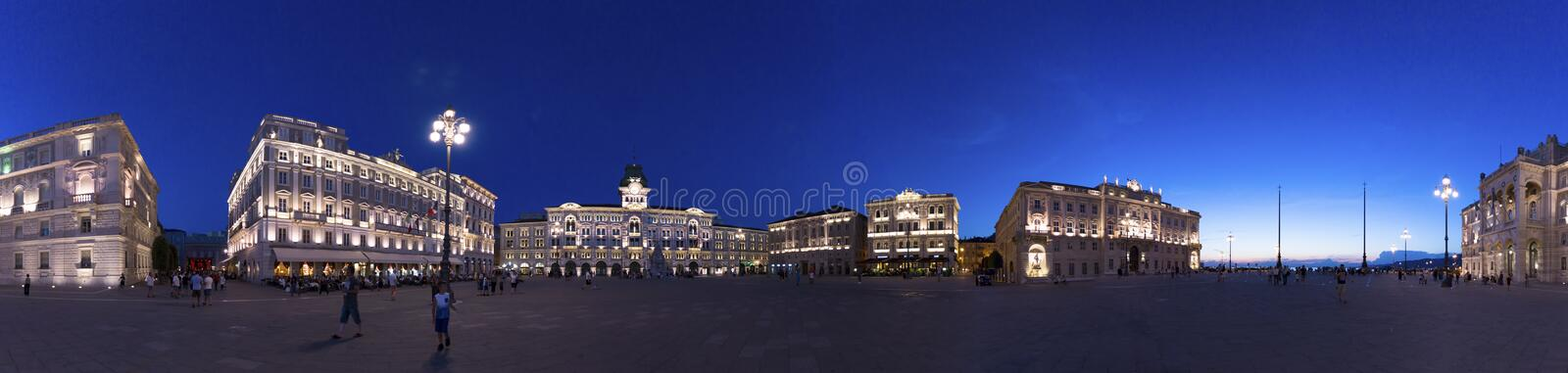 Panoramic photograph of Piazza Unità d`Italia at dusk at blue hour, Trieste, Italy. Panoramic photograph of the Unity Square in Italy Piazza Unità d`Italia stock photo
