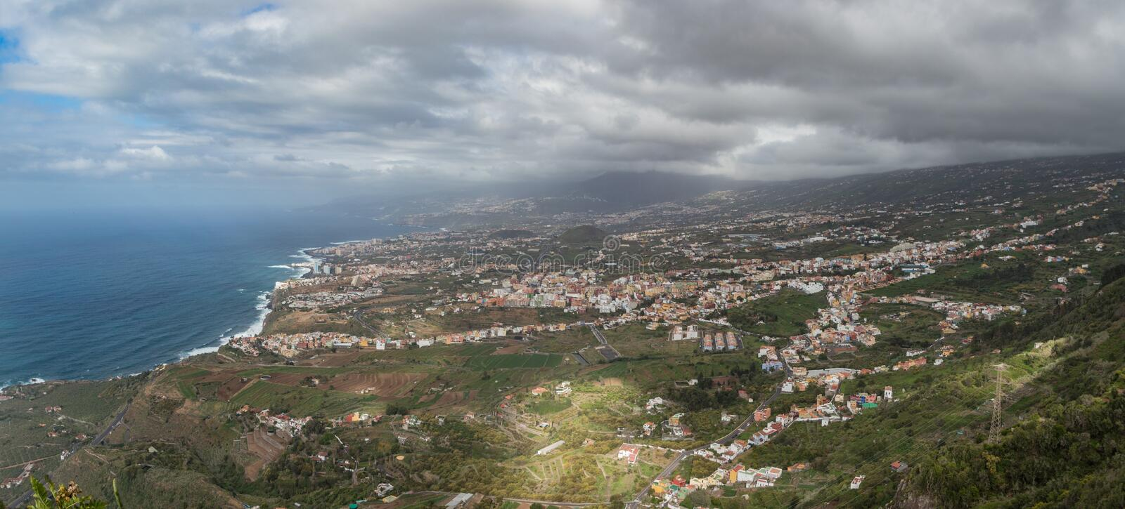 This panoramic photograph, taken at a Mirador de El Lance, shows the north coast of Tenerife and the Orotava Valley. Tenerife,. Canary Islands.. Wide angle lens royalty free stock photography