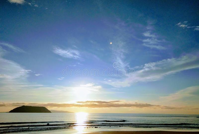 Panoramic Photography of Beach With Sun stock image