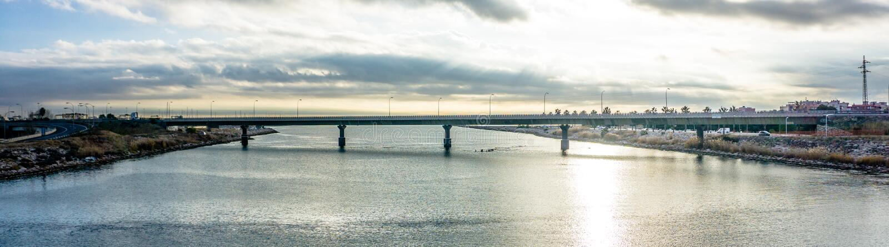 Panoramic Photography of Bridge Under Cloudy Sky royalty free stock photos