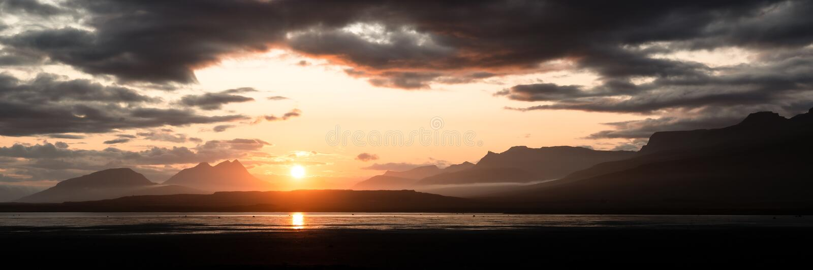Panoramic picture of beautiful sunset in the mountains over a river valley in Iceland. Panoramic picture of beautiful sunset in the mountains over a wide river stock photo